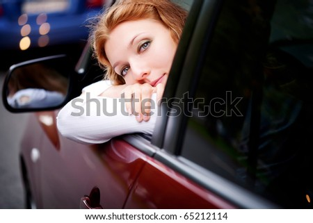 Woman Sitting In Car. Getting Ready To Drive