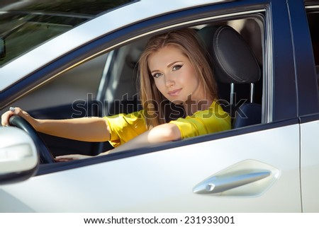 woman sitting in car, Happy girl driving automobile, outdoors summer portrait - stock photo