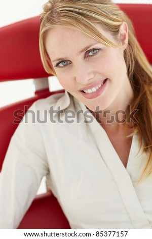 Woman sitting in chair - stock photo