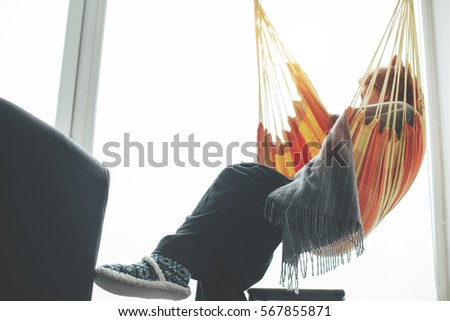 woman sitting in hammock in front of big bright window and chilling cheerful young woman chilling hammock laptop stock photo 567855694      rh   shutterstock