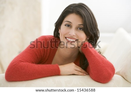 Woman sitting in living room - stock photo