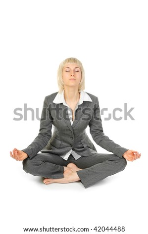 Woman sitting in lotus position isolated on white background