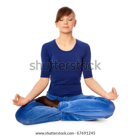 Woman sitting in lotus posture in the health club dressed in blue clothes and meditating - stock photo