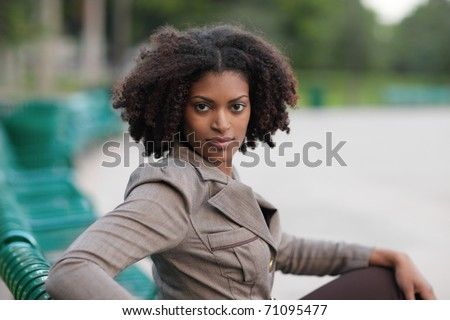 Woman sitting in the park - stock photo