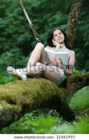 Woman sitting in the park and reading.