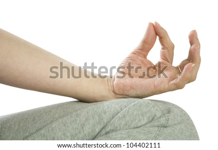 woman sitting meditating against a white background close up