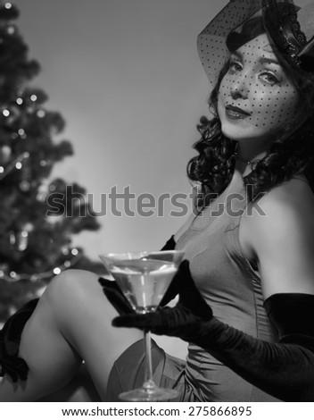 Woman sitting near a Christmas tree - stock photo