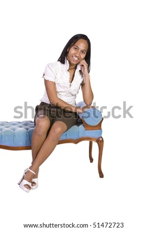 Woman sitting on a blue antique chair with white background
