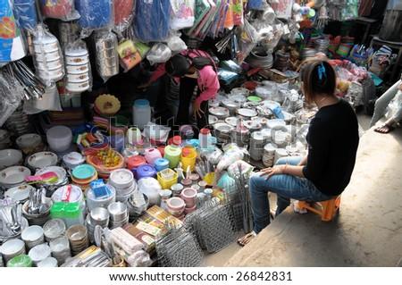 Woman sitting on a market stall,Kratie Cambodia 14.01.2009 - stock photo