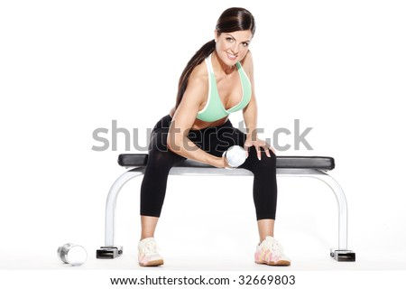 Woman Sitting on Bench with Dumbell - stock photo
