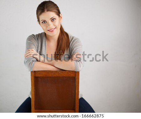 Woman sitting on chair , beautiful model . Chair back . Isolated . - stock photo