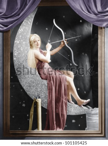 Woman sitting on crescent moon with bow and arrow - stock photo