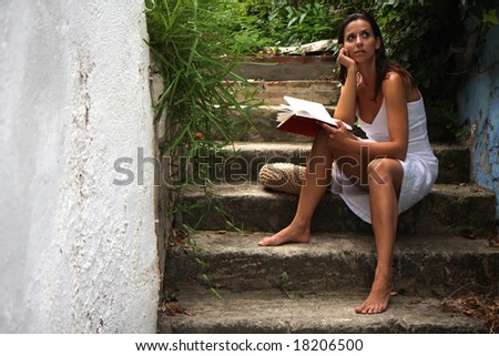Woman sitting on romantic old stairs - stock photo