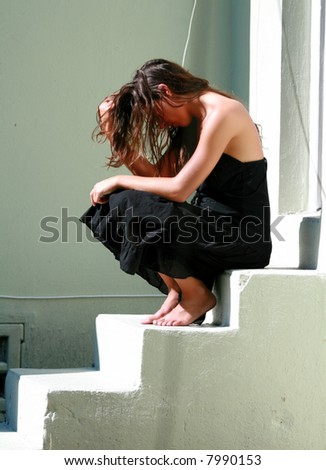 woman sitting on steps thinking