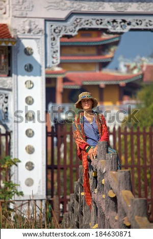 woman sitting on the background of a Buddhist temple