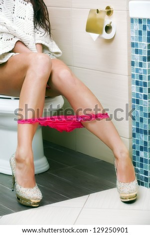 woman sitting on the bath-tub;