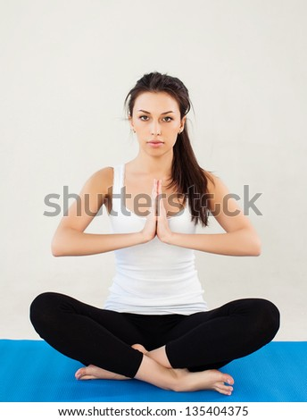 woman sitting on the carpet - stock photo