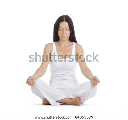 woman sitting on the floor exercising yoga - isolated on white - stock photo