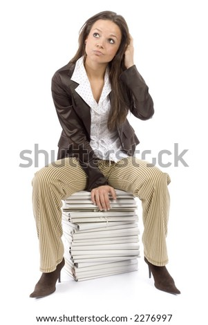 woman sitting on the heap of files - thinking (white background)