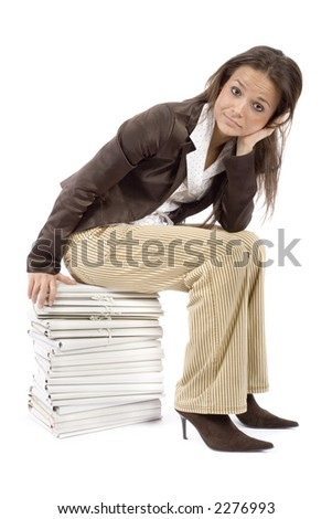 woman sitting on the heap of files (white background) - stock photo