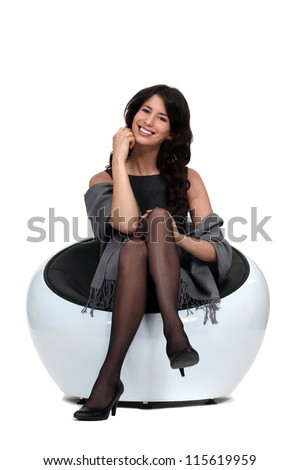 woman sitting on white chair - stock photo