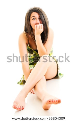 Woman sitting on white floor