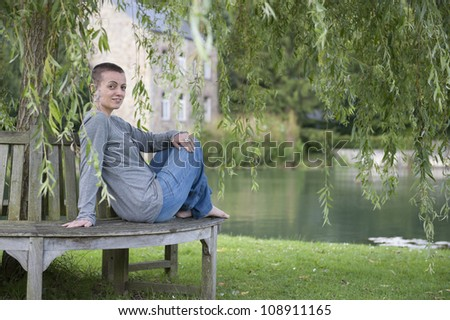 woman sitting outdoors in the park