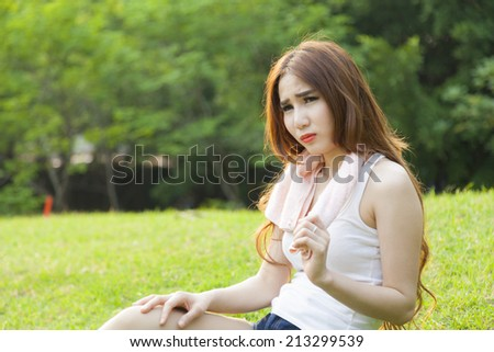 Woman sitting rest after exercise Inside the park