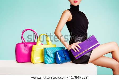 Woman sitting with colorful bags. leather products fashion image.  - stock photo