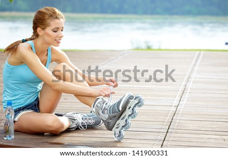 woman skating with rollerblades in a park - stock photo