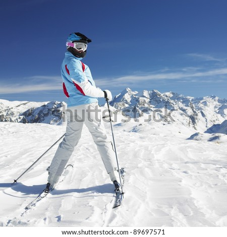 woman skier, Alps Mountains, Savoie, France - stock photo