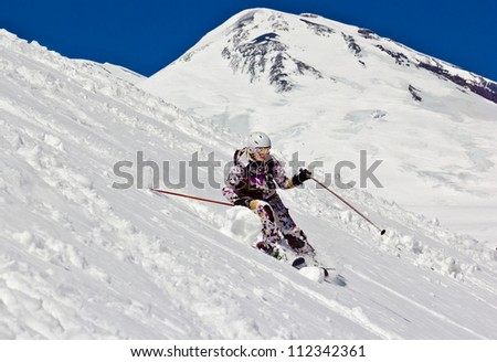 Woman skier off piste. Against the background of the big mountain.