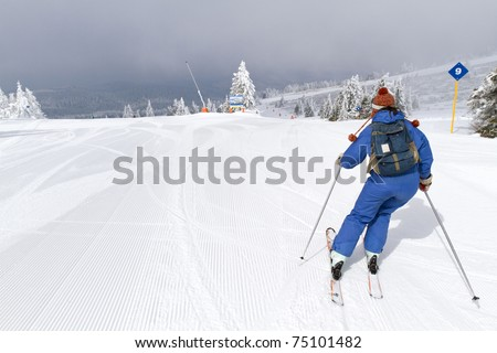 woman skiing on empty ski slope - stock photo