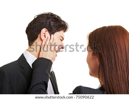 Woman slaping businessman in the face after sexual harrasment - stock photo