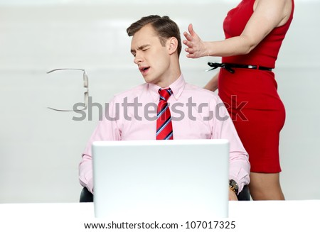 Woman slapping corporate male tightly for misbehaving with her - stock photo