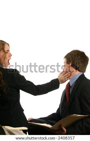 Woman slapping man at office - stock photo