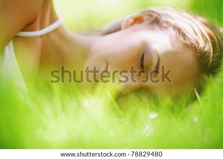 woman sleep on grass - stock photo