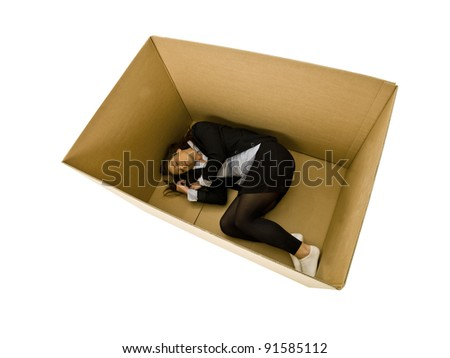 Woman sleeping in a cardboard box isolated on white background - stock photo