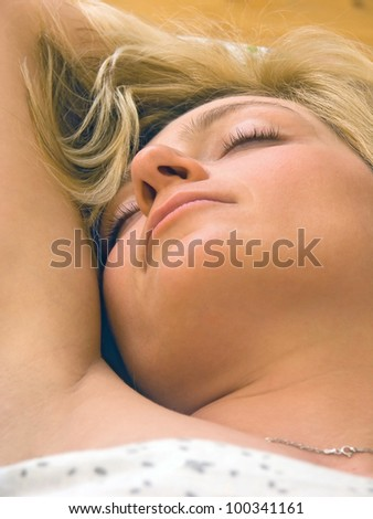 woman sleeping in bed - stock photo