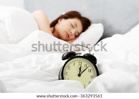 Woman sleeping in bed.