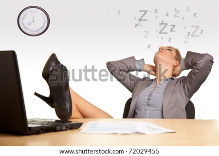 Woman sleeping in office - stock photo