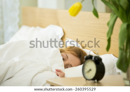 Woman sleeping in the bed  - stock photo