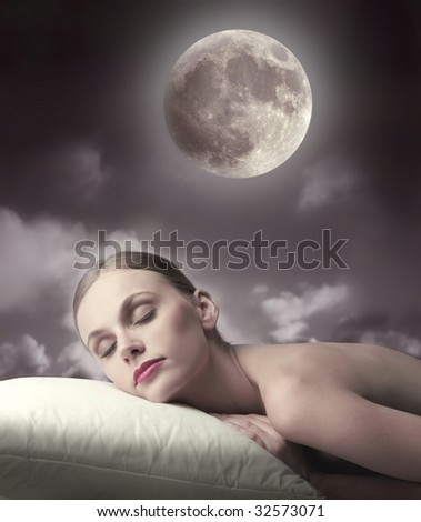 woman sleeping in the moonlight - stock photo