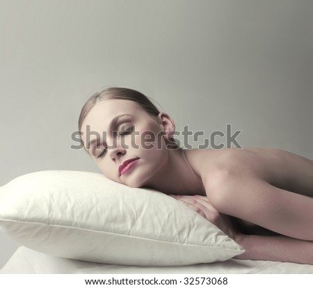 woman sleeping on a pillow - stock photo