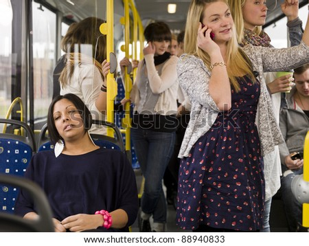 Woman sleeping while going by bus - stock photo
