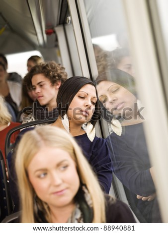 Woman sleeping while going by the bus - stock photo