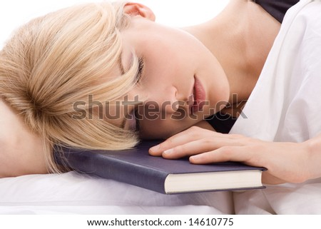 woman sleeping with book in hand