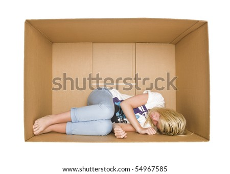 Woman sleeps in a cardboard box isolated on white background - stock photo
