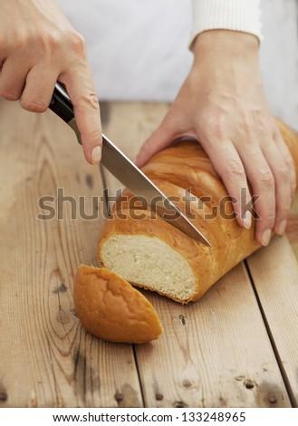 Woman Slicing Bread - stock photo