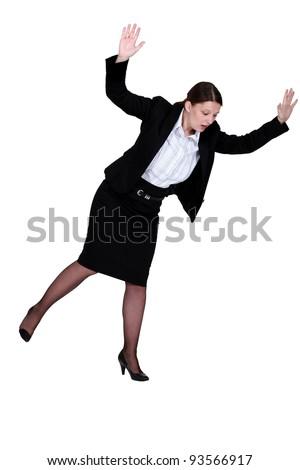 Woman slipping on the floor - stock photo